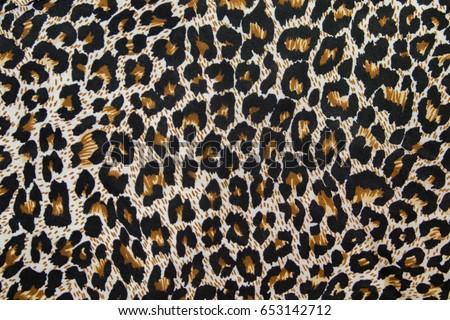 Leopard pattern texture. Textile, piece of clothes.