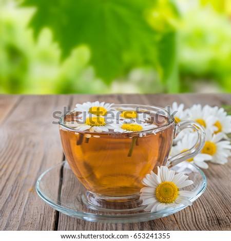 Chamomile tea on rustic table #653241355