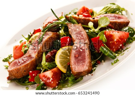 Beef with vegetables on white background  #653241490