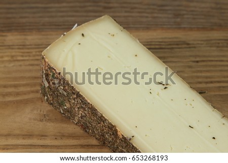 Traditional Swiss cheese on wooden table #653268193