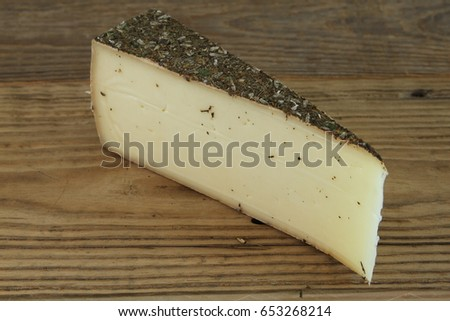 Traditional Swiss cheese on wooden table #653268214