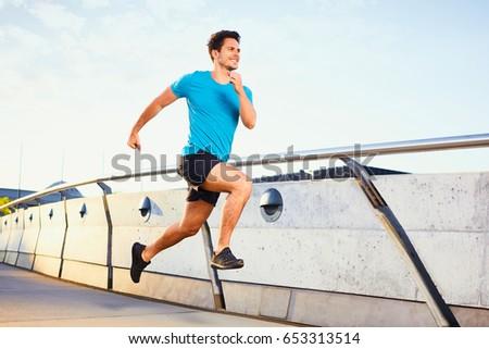 Picture of happy man running on bridge