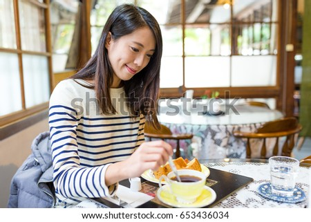 Woman enjoy her breakfast #653436034