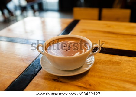 White coffee mug lay on wooden background. #653439127