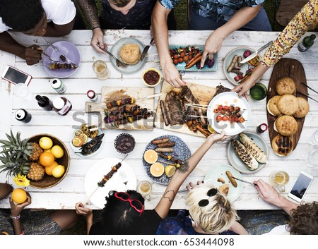 Aerial view of diverse friends gathering having food together #653444098