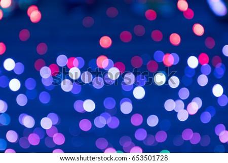 Festive color lights, focus outside the image.Bokeh lamp colorfull.Like a rainbow as beautiful #653501728