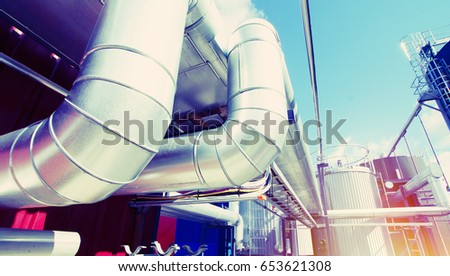 Equipment, cables and piping as found inside of a industrial power plant #653621308