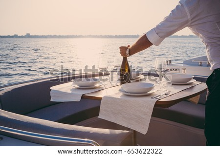 romantic lunch on motor yacht at sunset, Table setting at a luxury yacht. #653622322