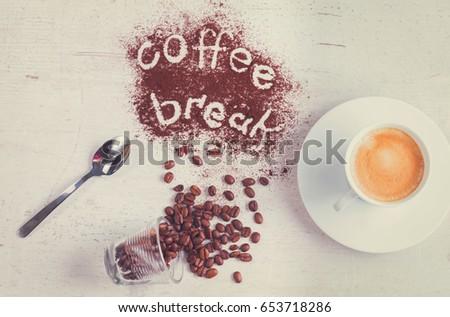 coffee break concept - cup of espresso, spoon and coffee break lettering, retro toned #653718286