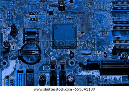 Abstract close up of Electronic Circuits in Technology on Mainboard computer background  (logic board,cpu motherboard,Main board,system board,mobo)  #653841139