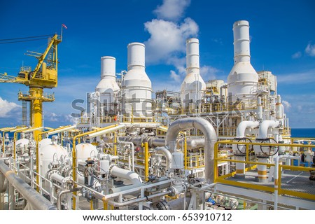Pipe work and exhaust stack at offshore oil and gas central processing platform. Royalty-Free Stock Photo #653910712