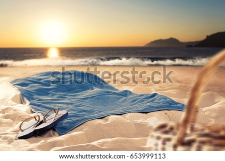 empty space on summer towel on beach and sunset time  #653999113