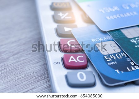 Selective focus, Credit card payment on calculator closeup shot for background. #654085030