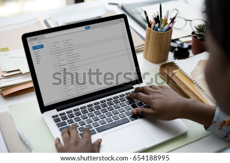 Woman using laptop for checking email #654188995