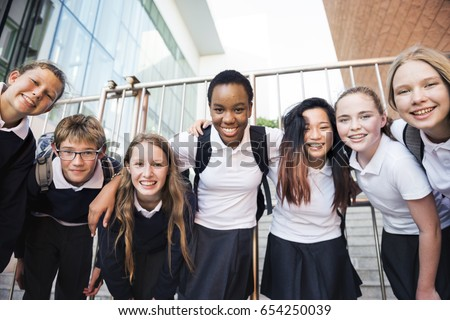 Group of students huddle together Royalty-Free Stock Photo #654250039
