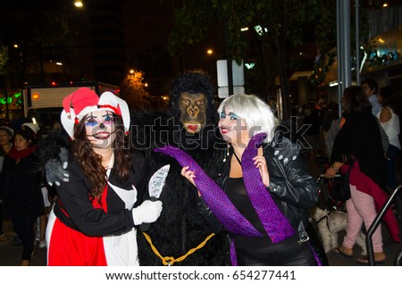 Quito, Ecuador - December 31, 2016: An unidentified group of people wear customs as widowed, king kong and Harley Quin, to celebrate new year in Ecuador #654277441