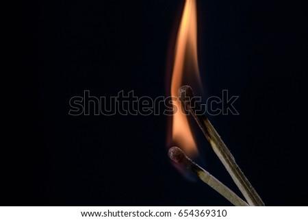 Burning matchstick #654369310