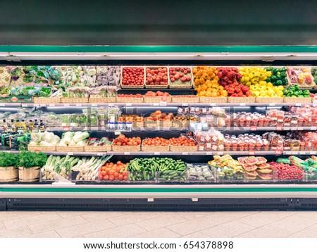 Fresh vegetables on shelf in supermarket for background Royalty-Free Stock Photo #654378898