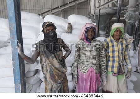 Katni / India 10  May 2017 Group portrait of  stone crushing factory workers   at  Katni  Madhya Pradesh India #654383446
