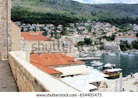 view on the port in the old town of Dubrovnik #654405475