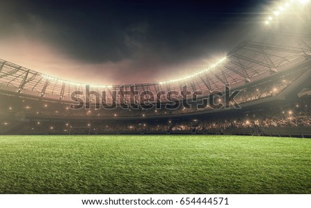 soccer stadium with illumination, green grass and night sky Royalty-Free Stock Photo #654444571