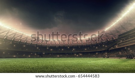 soccer stadium with illumination, green grass and night sky Royalty-Free Stock Photo #654444583