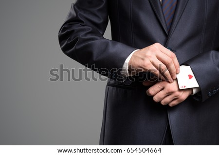 Concept - ace in the sleeve. Royalty-Free Stock Photo #654504664