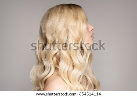 Portrait Of Beautiful Young Blond Woman With Long Wavy Hair. #654514114
