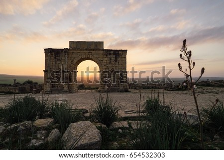 The Arch of Caracalla in Volubilis. Volubilisis a partly excavated Berber and Roman city situated near the city of Meknes, and commonly considered as the ancient capital of the kingdom of Mauretania. #654532303