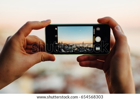 Cityscape in smart-phone screen #654568303