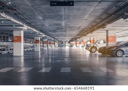 interior of parking garage with car and vacant parking lot in parking building, vintage style process #654668191