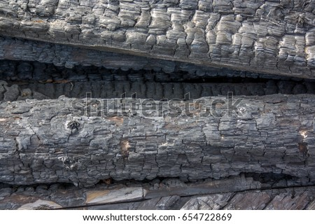 burnt wood texture. Texture of charred wood close-up #654722869