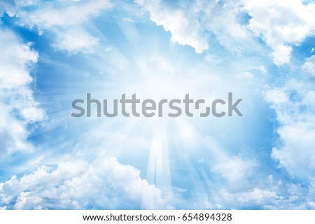 Bright sun shining in clouds Royalty-Free Stock Photo #654894328