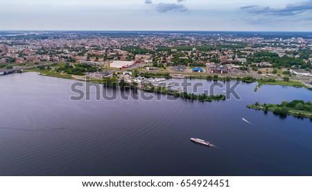 Aerial view of city Riga river Daugava in cloudy day #654924451