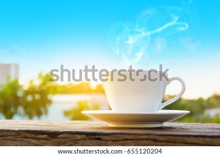 coffee cup clock  on old wooden table nature background the good morning #655120204