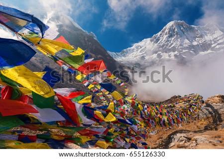 Prayer flags and Mt. Annapurna I background from Annapurna Base Camp ,Nepal. #655126330
