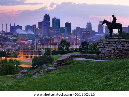 View of Kansas City, Missouri skyline at dawn during golden light from the Kansas City Scout Memorial with all registered trademarks removed. #655162615