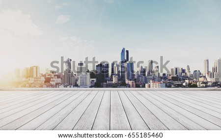 Panoramic city view in sunrise with wooden floor #655185460