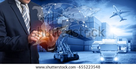 Hand holding tablet is pressing button on touch screen interface in front Logistics Industrial Container Cargo freight ship for Concept of fast or instant shipping, Online goods orders worldwide #655223548