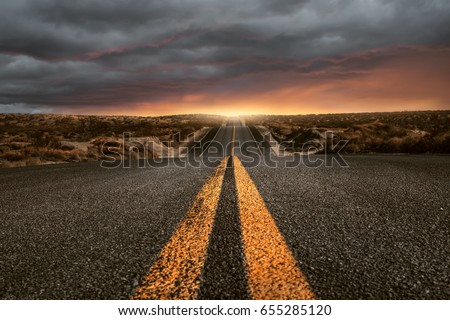 Hilly country road Royalty-Free Stock Photo #655285120
