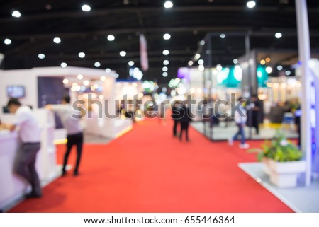 Abstract blur people in exhibition hall event trade show background Royalty-Free Stock Photo #655446364