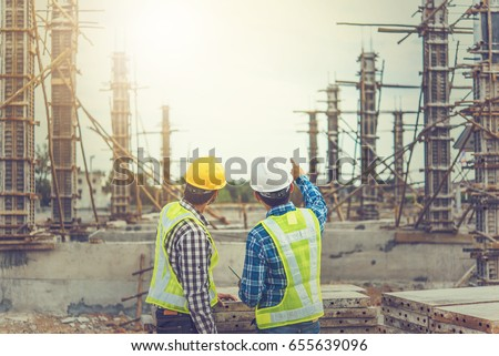 Two young man architect on a building construction site #655639096
