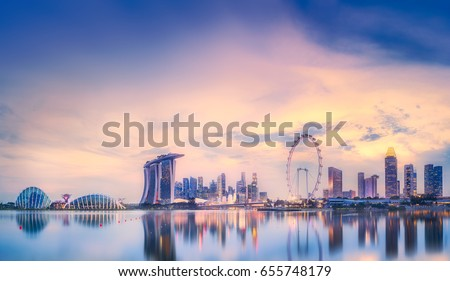 Vibrant panorama background of Singapore skyline at the business bay Royalty-Free Stock Photo #655748179