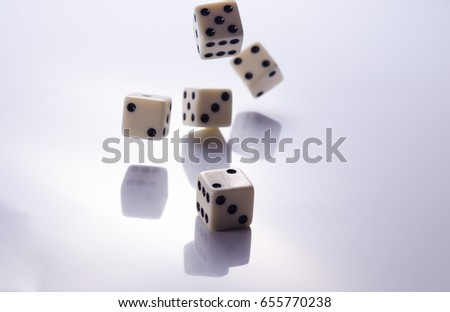 Playing white dice on a light background closeup #655770238