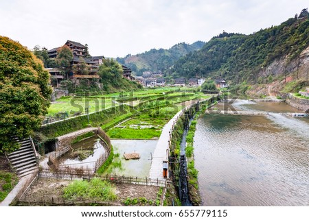 travel to China - view of irrigation canal and rice fields in Chengyang village of Sanjiang Dong Autonomous County in spring season #655779115