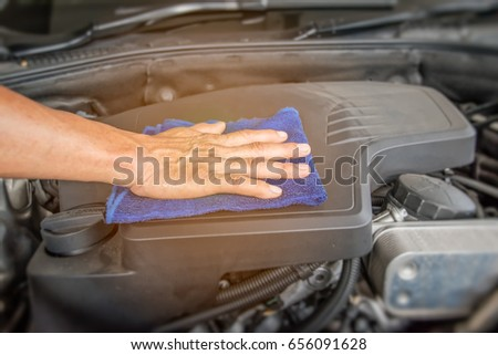 Clean the car engine. #656091628