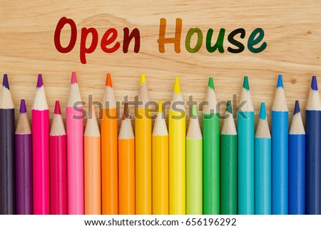 Open House text with colorful pencil crayons on a desk #656196292