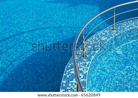 Blue water in a pool with tiles #65620849