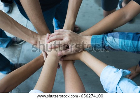 Team work concept. Business people joining hands #656274100