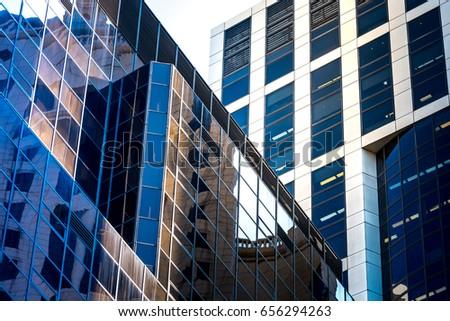 Modern office building close up in sunlight , Hong Kong #656294263